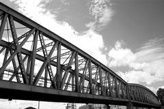Railway bridge in Paris. Truss railway bridge an cloudy sky Stock Image