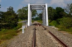 Railway bridge with rail tracks parallel to highway in Sri Lanka Stock Image