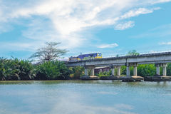 Railway bridge. Railroad bridge in Thailand, The train is crossing the bridge on river Royalty Free Stock Photography