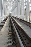 Railway bridge rails, stretching into perspective Royalty Free Stock Images