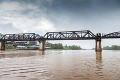 Railway Bridge in the rain cloud, River Kwai, Kanchanaburi, Thailand Stock Photos