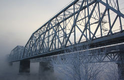 Railway bridge through the river. In the winter Stock Photo