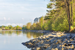 Railway bridge through the river Berd. Berdsk, Siberia, Russia. River Ave, city of Berdsk, Novosibirsk oblast, Siberia, Russia - may 14, 2017: view of the Royalty Free Stock Photography