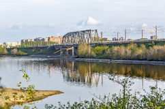 Railway bridge through the river Berd. Berdsk, Siberia, Russia. River Ave, city of Berdsk, Novosibirsk oblast, Siberia, Russia - may 14, 2017: view of the Royalty Free Stock Photos