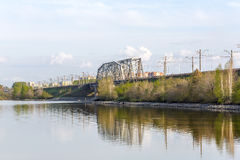 Railway bridge through the river Berd. Berdsk, Siberia, Russia. River Ave, city of Berdsk, Novosibirsk oblast, Siberia, Russia - may 14, 2017: view of the Royalty Free Stock Photo
