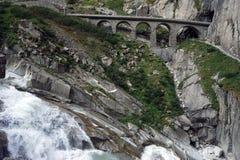 Railway bridge. And river near mountain in Switzerland Royalty Free Stock Photos
