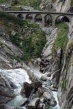 Railway bridge. And river near mountain in Switzerland Stock Photo