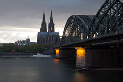 Railway Bridge on River Rhine against Cologne Cathedral Stock Image