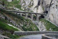 Railway bridge. And slope near Andermatt in Switzerland Stock Images