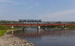 Railway bridge and a small train Royalty Free Stock Photography
