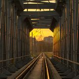 Railway bridge of steel structures, on a sunset background. Close up stock images