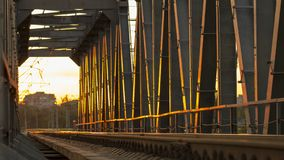Railway bridge of steel structures, on a sunset background. Close up stock photography