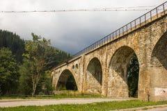 Railway bridge. On the stone bridge laid railroad tracks Royalty Free Stock Photography