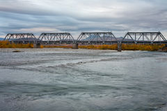 Railway bridge surrounded by autumn landscapes. Polar Urals. Russia Royalty Free Stock Photo