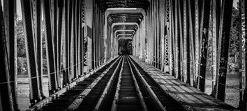 Railway bridge and tracks - single point perspective. Royalty Free Stock Photography