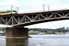Railway bridge in Warsaw. Railway bridge over Vistula river with a train in Warsaw, Poland. Picture date: 2017-06-25 Royalty Free Stock Photo