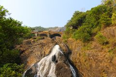 Railway bridge through the waterfall Dudhsagar royalty free stock photography