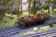 Railway carriage model loaded with scrap metal. On rails in landscape royalty free stock image