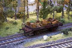 Railway carriage model loaded with scrap metal. On rails in landscape Stock Photography