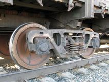 The railway carriage springs and wheels on reils close-up royalty free stock images