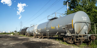 Railway Chemical Tank. Railroad Chemical and Oil Tank Car in a fiel on a nice sunny day royalty free stock images