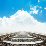 Railway closeup to horizon in blue sky with clouds Stock Image