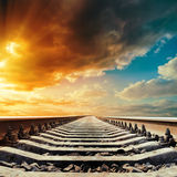 Railway closeup to horizon under sunset Stock Image