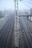 Railway in the cold misty morning Royalty Free Stock Photo