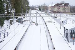 Railway covered in winter white snow cancelled train service. Railway covered in white snow cancelled train service during harsh winter weather Royalty Free Stock Images