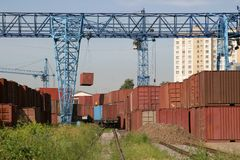 Railway crane and containers Royalty Free Stock Photos