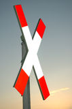 Railway cross 2. Red-white railway cross sign against evening sky royalty free stock photo