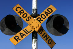 Railway Crossing. Crossing Railroad sign with two lights on a deep blue sky Stock Photos