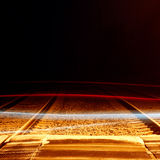 Railway Crossing. An abstract image of a railway crossing showing streaks of moving vehicles crossing at night Royalty Free Stock Photography