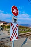 Railway crossing without barriers. Crossing a street with a train without barriers royalty free stock photos
