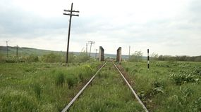 A railway crossing a bridge over a green field royalty free stock photography