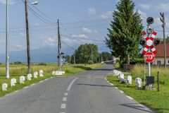 Railway crossing on a country road Royalty Free Stock Photo