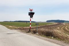 Railway crossing in the Czech Republic. Road crossing over the tracks. The inscription Stock Photography