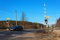Railway crossing in the Czech Republic. Road crossing over the tracks. The inscription Stock Photos