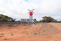 Railway Crossing on Dirt Track. Stock Image