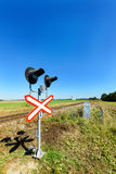 Railway crossing equipped with electric lights. Stock Photos