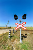 Railway crossing equipped with electric lights. Stock Image
