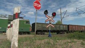 Railway crossing..Freight train. Freight. Railway crossing. Freight train industrialFreight stock video footage