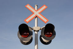 Railway Crossing Lights. And blue sky Stock Image
