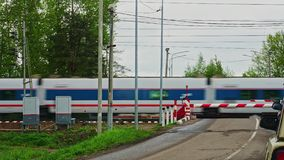 Railway crossing passing train. In Russia stock video footage
