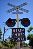 Railway crossing sign against blue sky royalty free stock photos