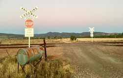 Railway crossing sign with Australian landscape. Stock Photos