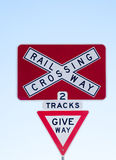 Railway crossing sign. Beware of trains coming on track stock photography