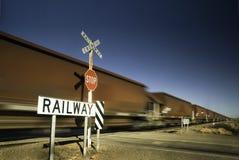 Speedy freight train crossing Stock Photo