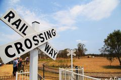 Railway Crossing Sign. A railway crossing sign at train shed, Sydney Australia stock image