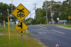 Railway crossing sign in yellow color. On street in Australia royalty free stock photo